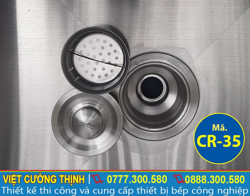 Bộ phận xả nước của chậu rửa 2 ngăn có kệ và tủ